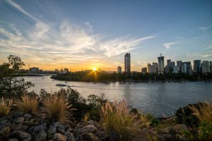 brisbane river with city cat at sunset