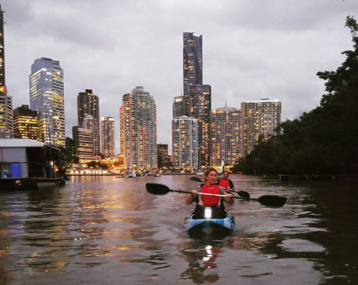 Kayaking past Riverside on the Brisbane river at night